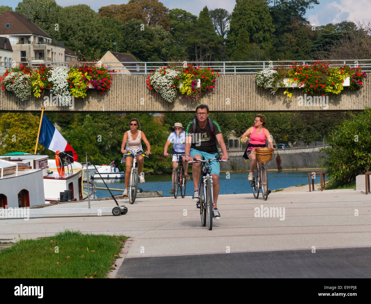 Group cyclists cycling towpath Rhine- Rhone canal Dole Franche-Compte France EU - Stock Image