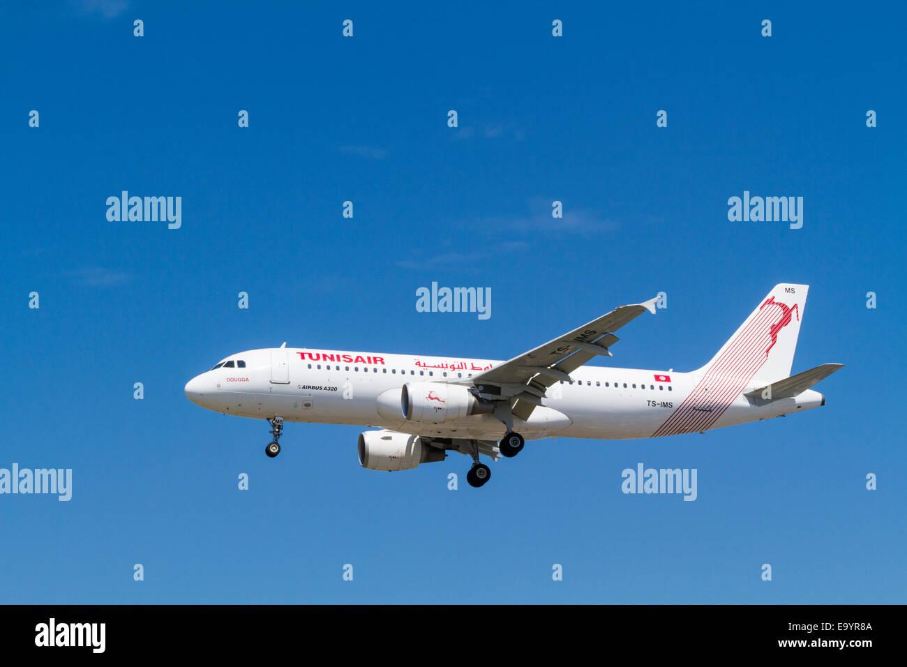 Tunisair Airbus A320-200, TS-IMS, named Dougga, on its landing approach at London Heathrow, England, UK - Stock Image