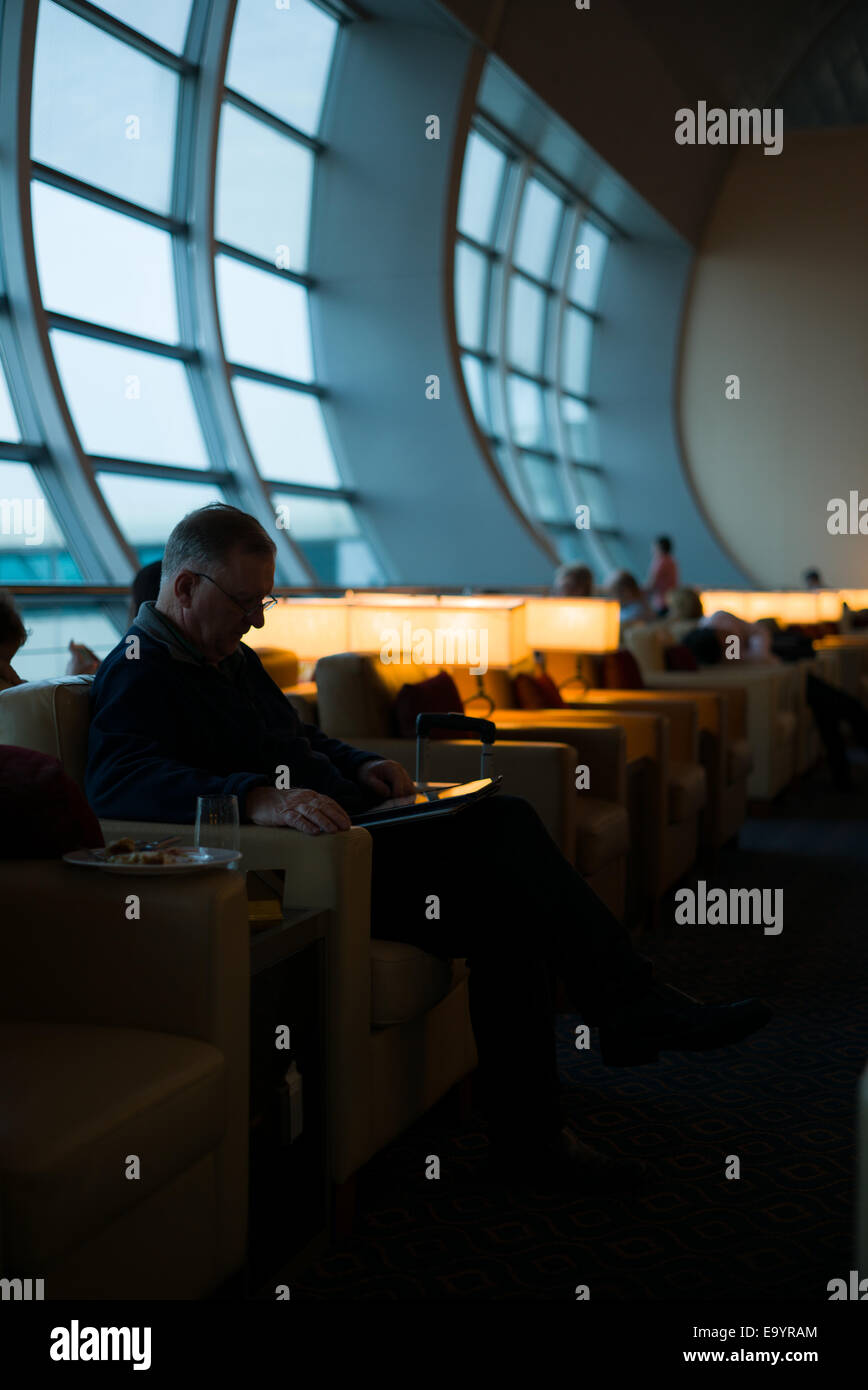 Traveller at Dubai International Airport Business Lounge. UAE. - Stock Image