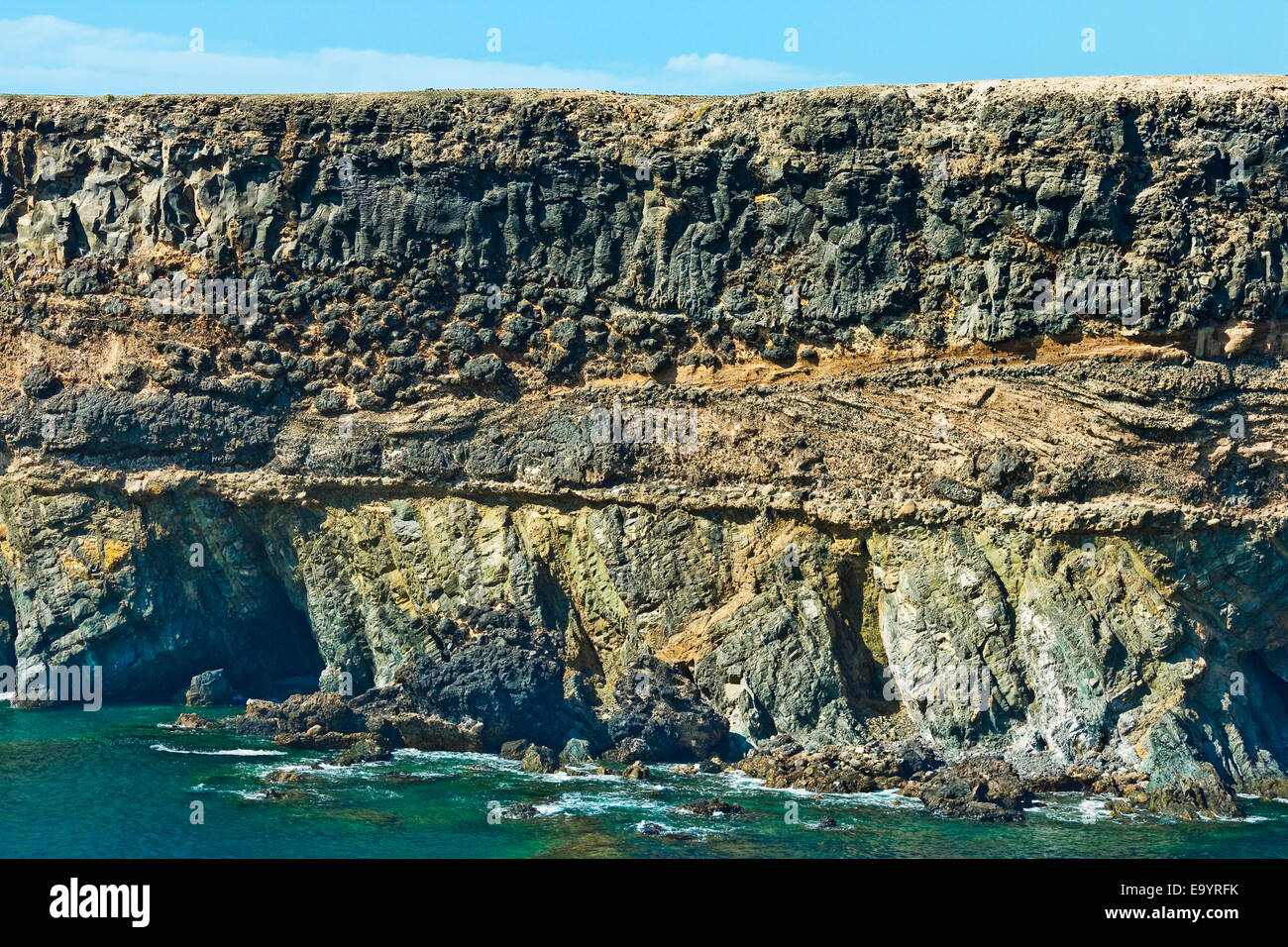 Pillow lava that formed underwater on unconformity of Jurassic & Pliocene sediments at Caleta Negra; Ajuy, Fuerteventura, - Stock Image