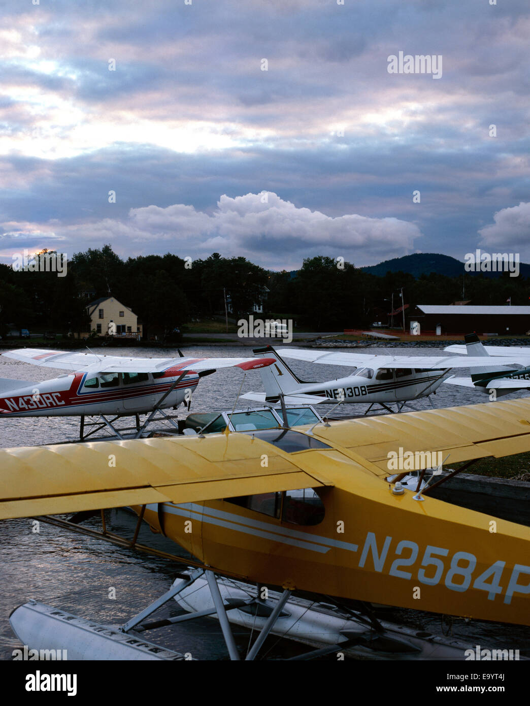 small sea planes docked on lake at Maine at dusk - Stock Image