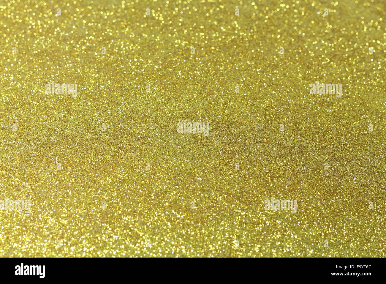 Background image of gold glitter/sparkle - Stock Image