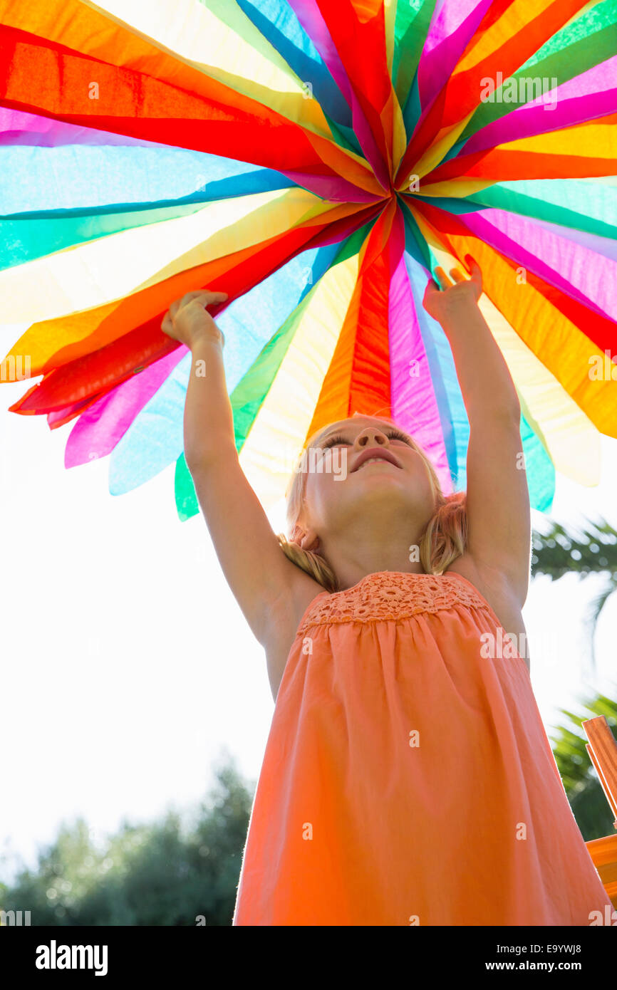Girl putting up decoration - Stock Image