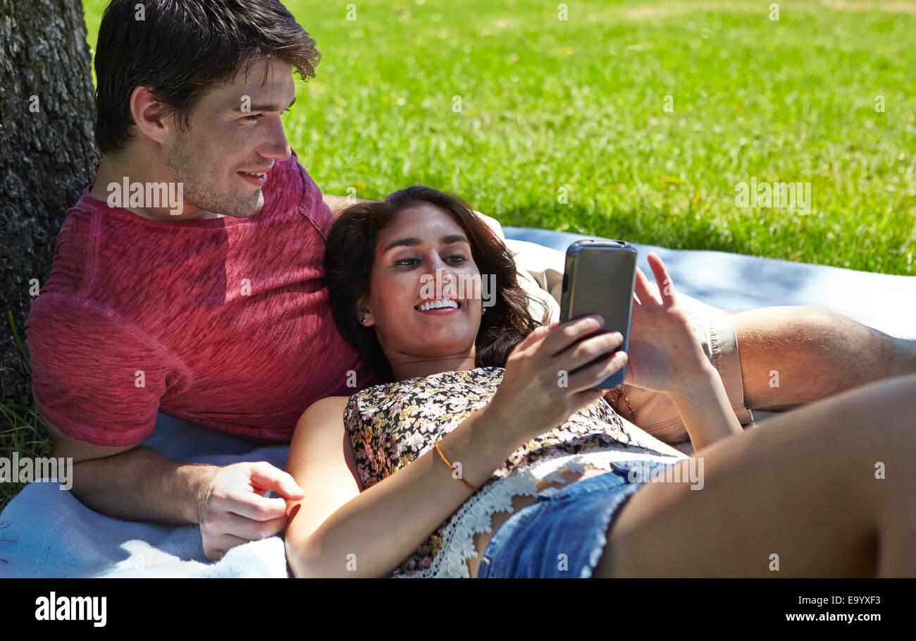 Young couple relaxing in park Stock Photo