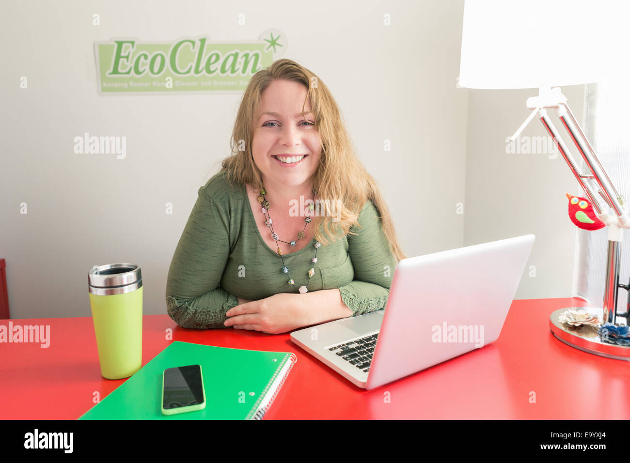 Small business owner of green cleaning company - Stock Image