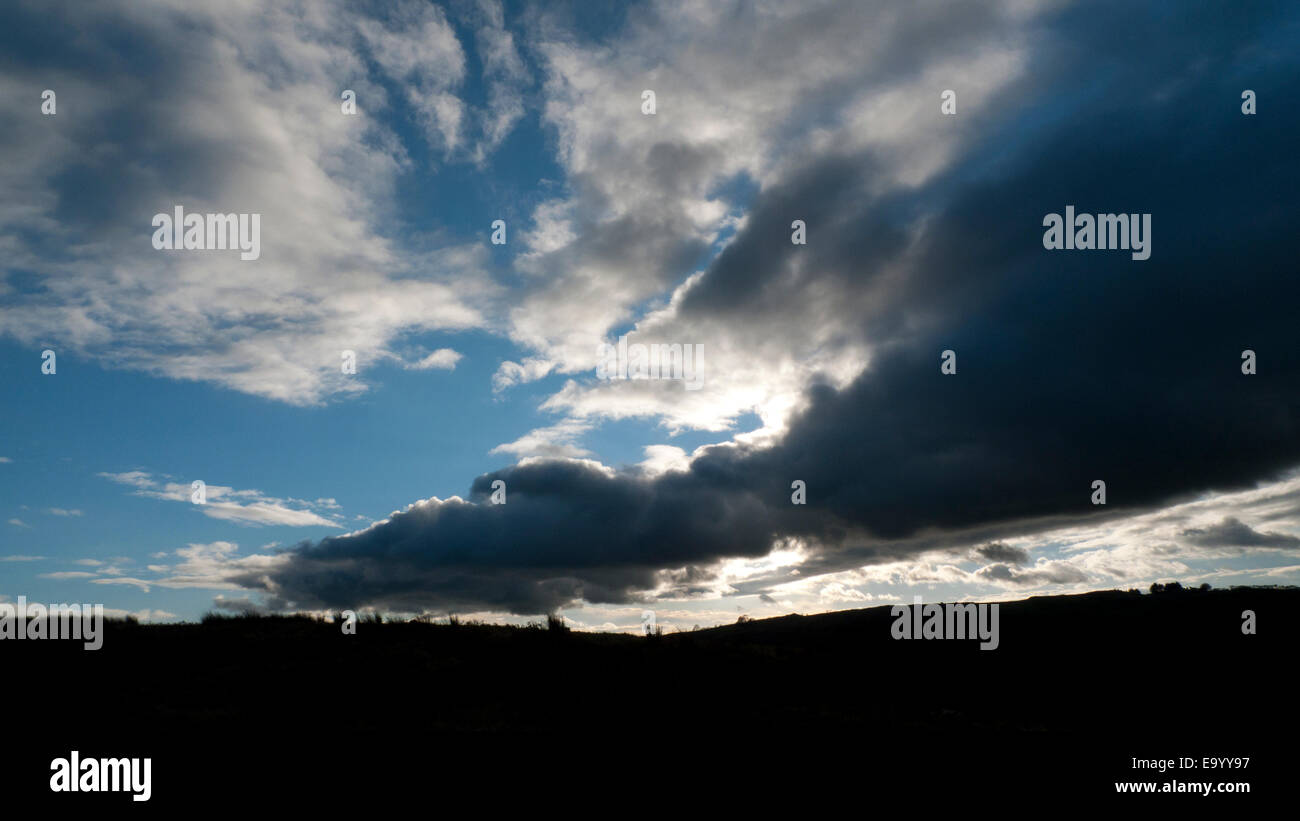 Carmarthenshire,Wales, UK. Tuesday 4th Nov 2014. In the late afternoon heavy dark clouds follow fine dry afternoon - Stock Image