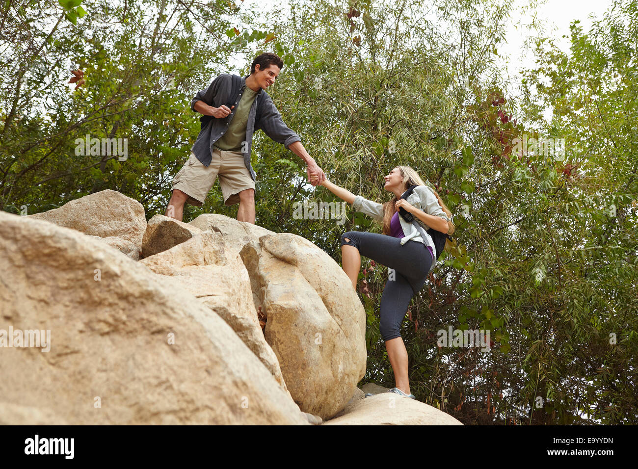 Couple rock climbing - Stock Image