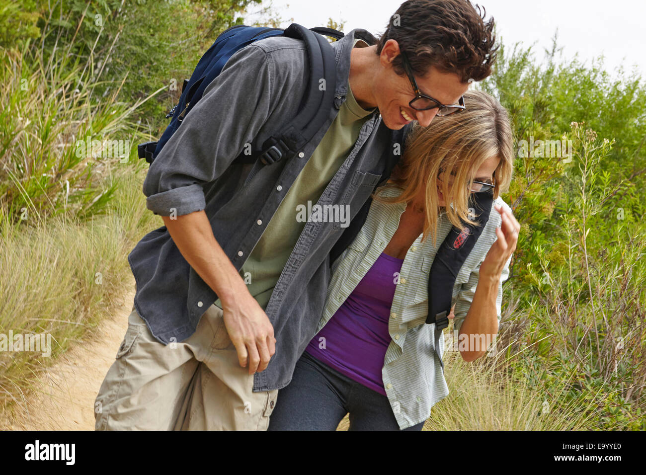 Couple enjoying walk in forest - Stock Image