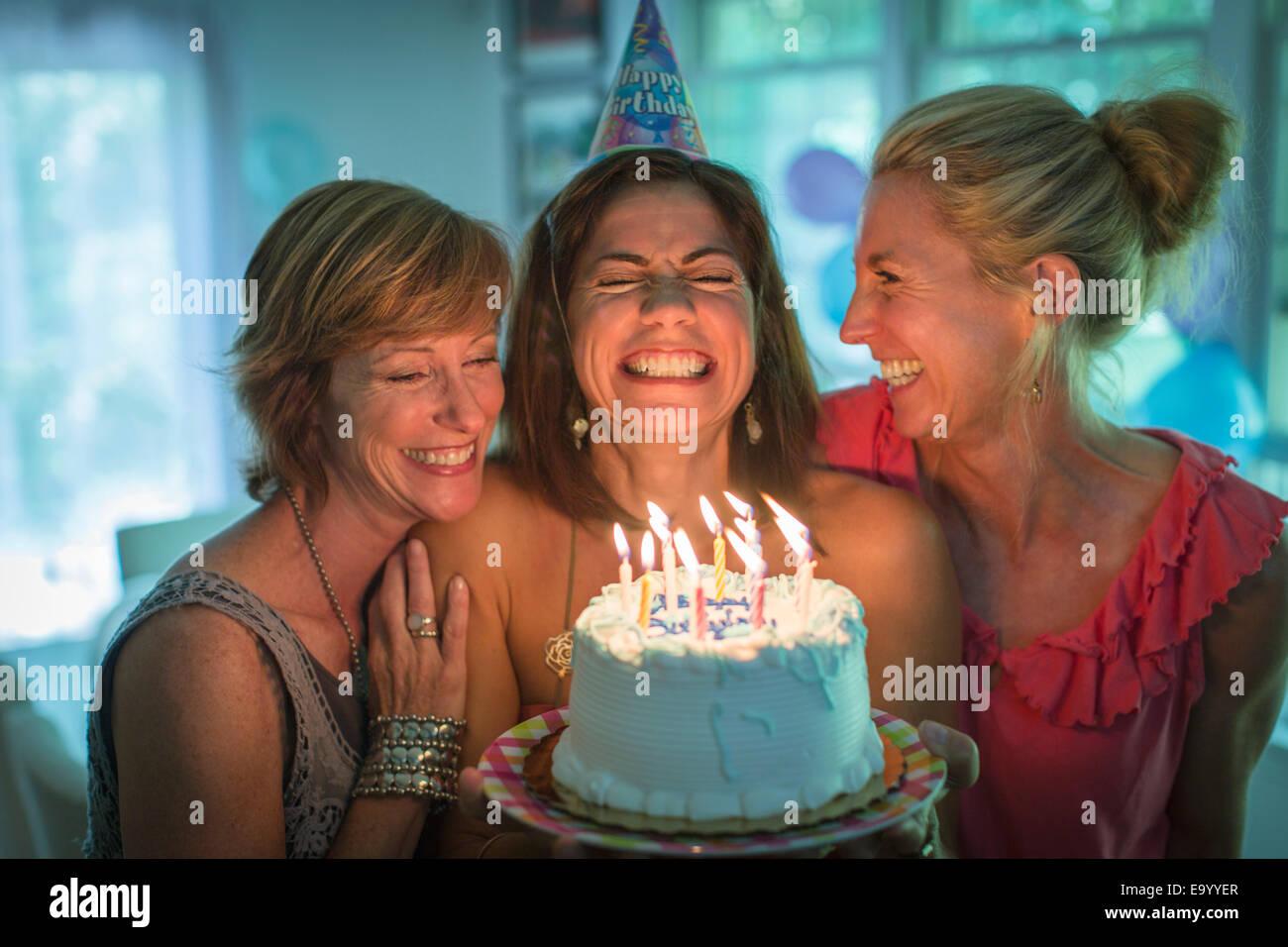 mature women friends laughing home stock photos & mature women