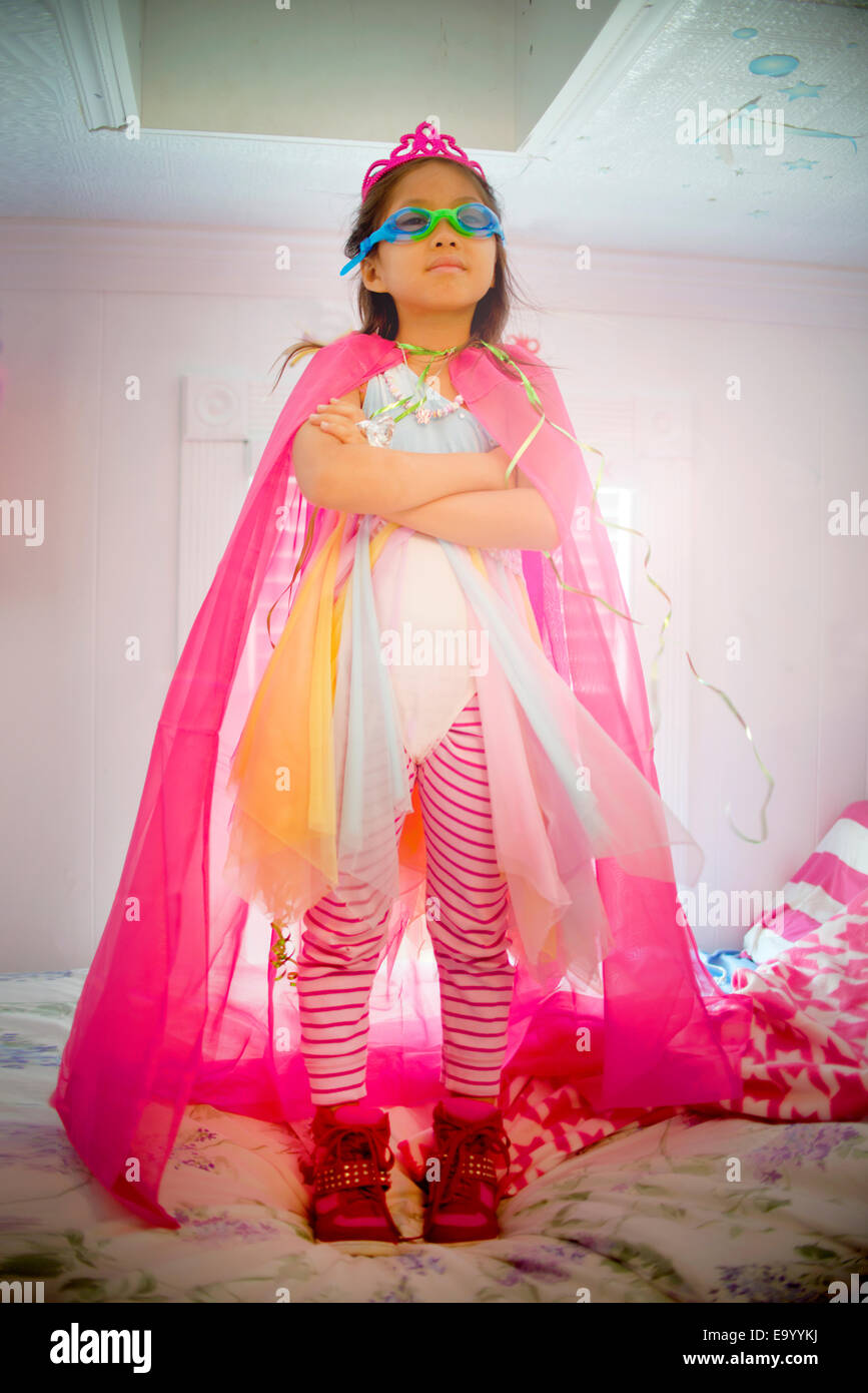 Portrait of young girl wearing fancy dress costume - Stock Image