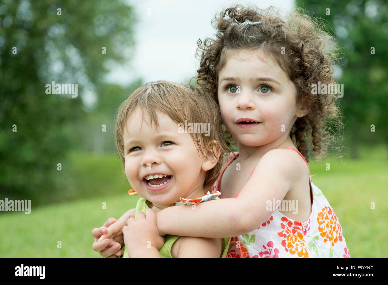 Portrait of two toddlers, playing - Stock Image