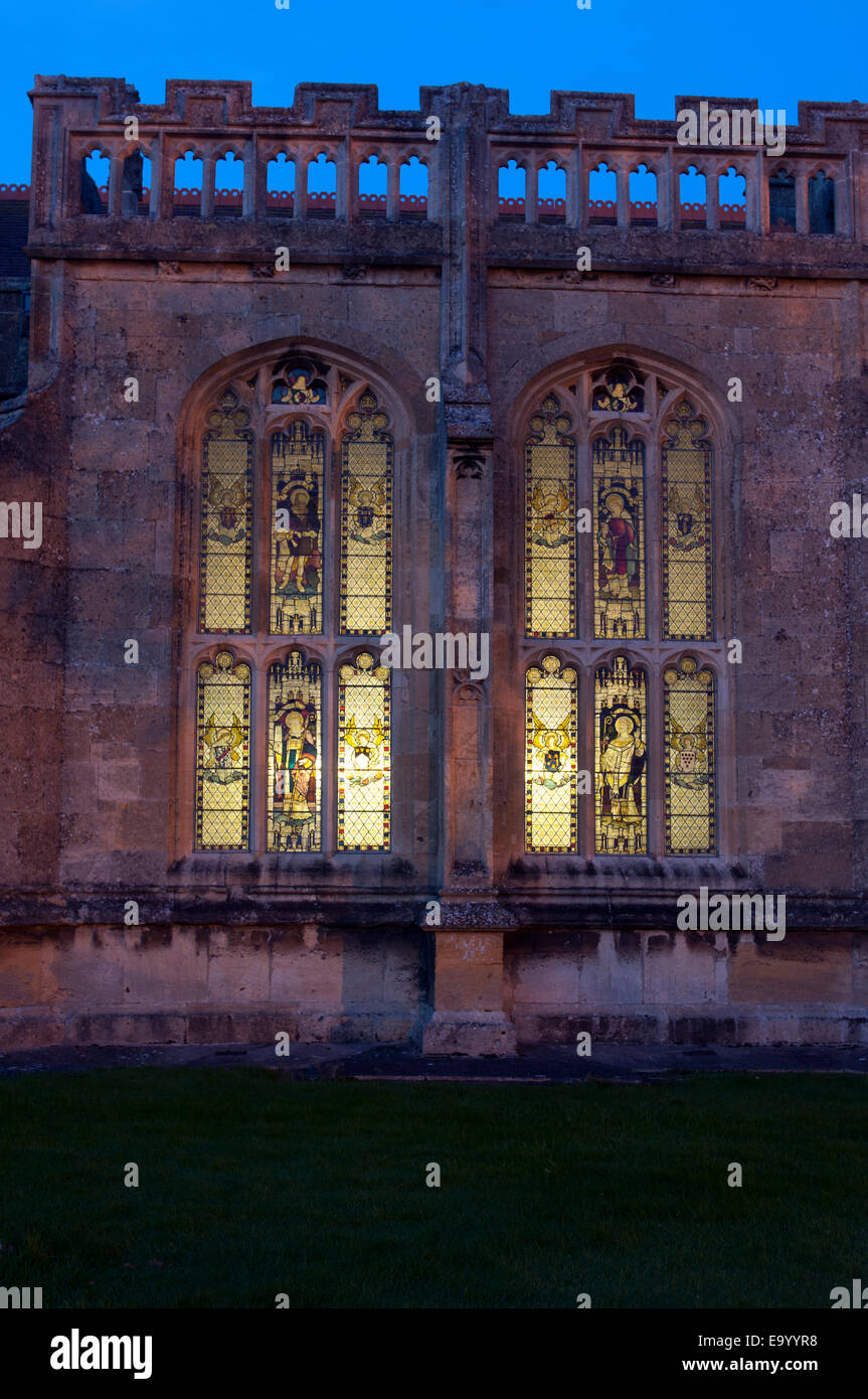 Interior lighting shining through windows of All Saints Church, Evesham, Worcestershire, England, UK - Stock Image