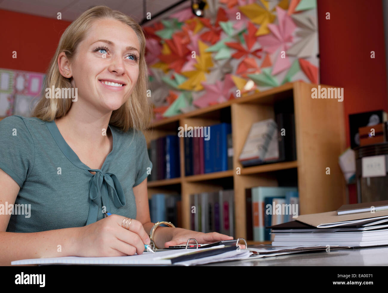 Sales assistant doing paperwork in stationery shop Stock Photo