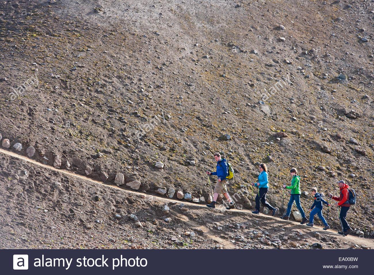 Family walking up a hill at Landmannalaugar, Fjallabak, Iceland - Stock Image