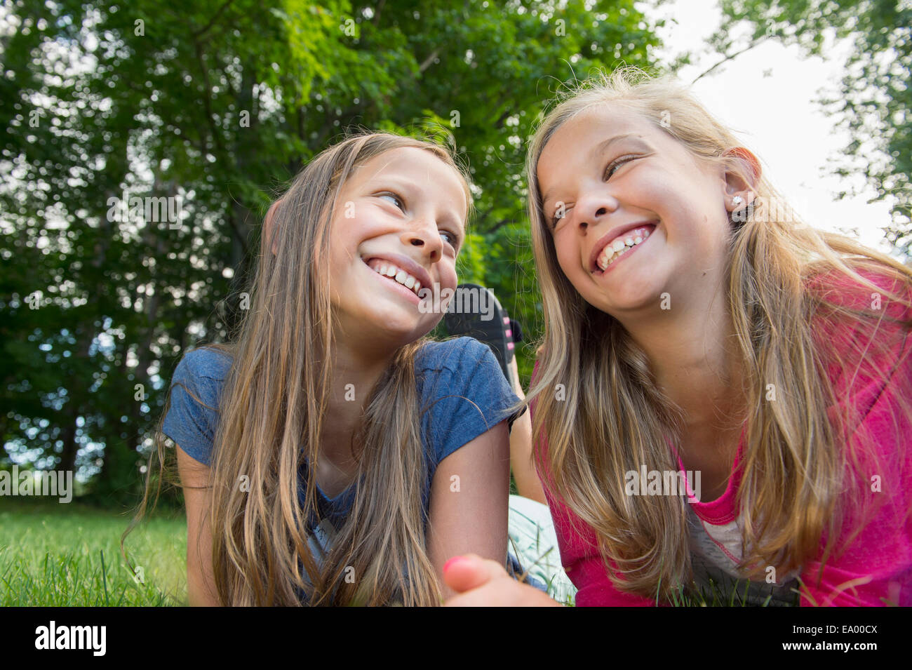 Friends lying on grass - Stock Image