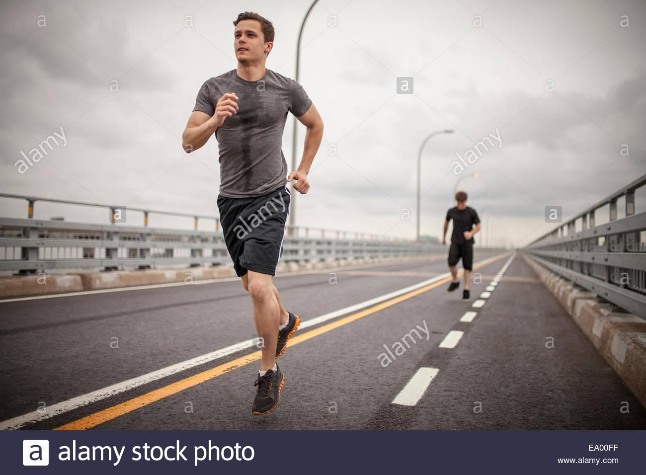 Young men jogging - Stock Image