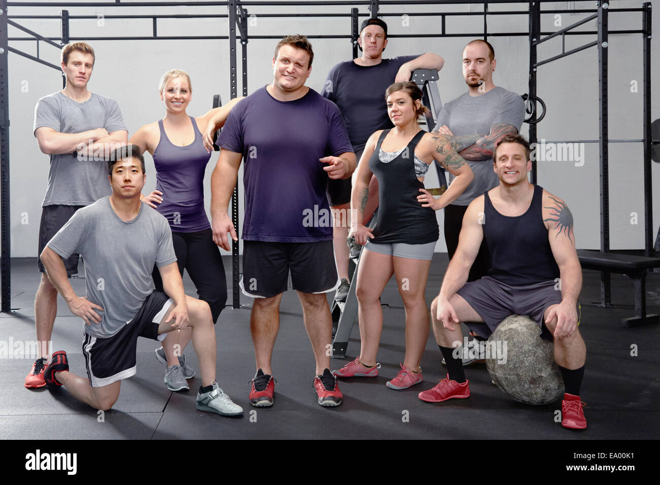 Portrait of eight people in gym - Stock Image