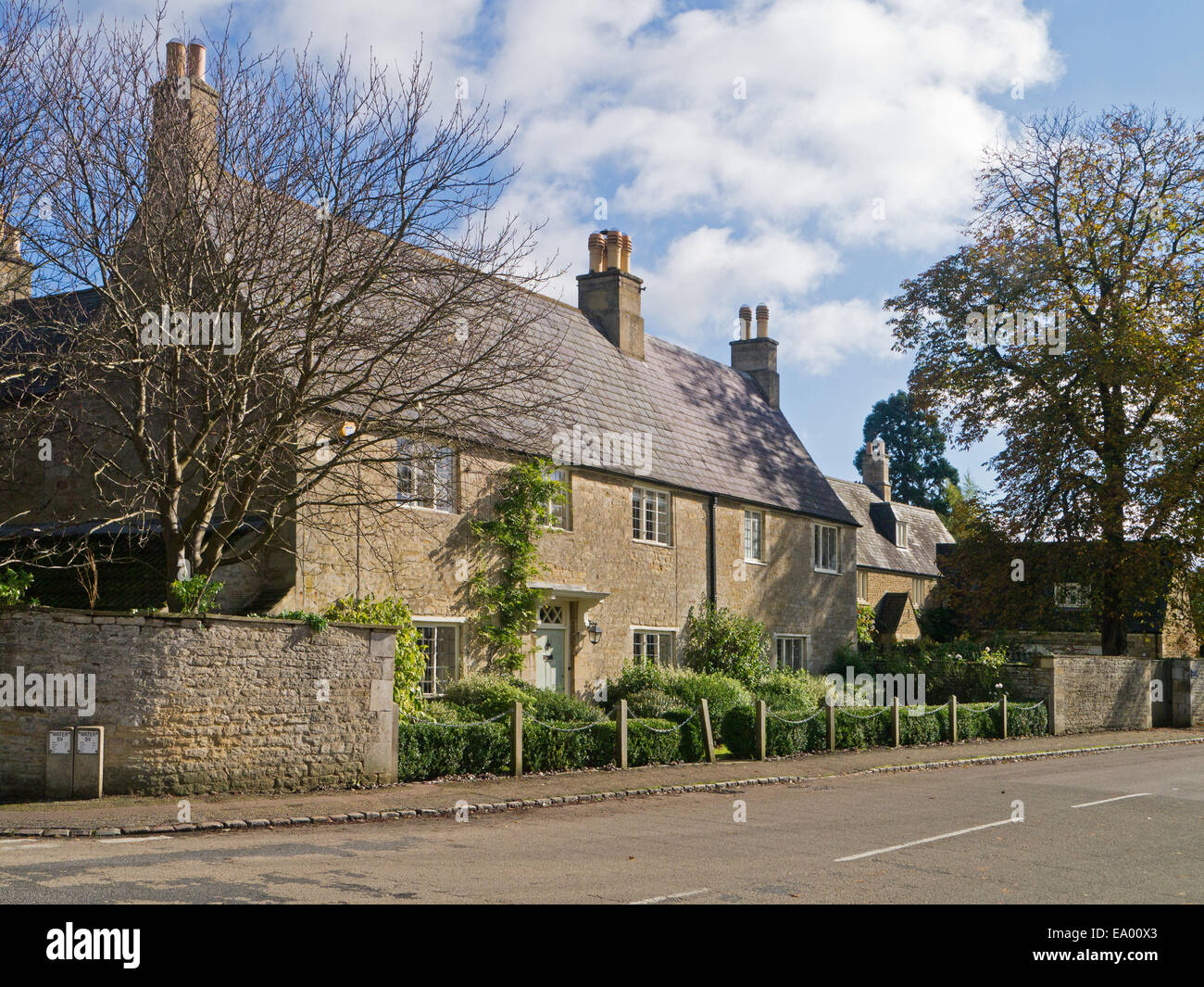 Substantial stone built house in the village of Fotheringhay, Northamptonshire, UK - Stock Image