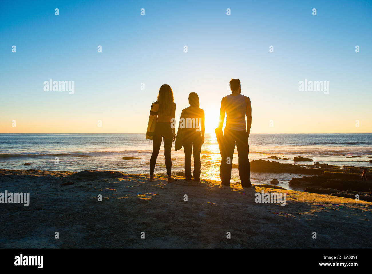 Three people at Windansea beach, La Jolla, California - Stock Image