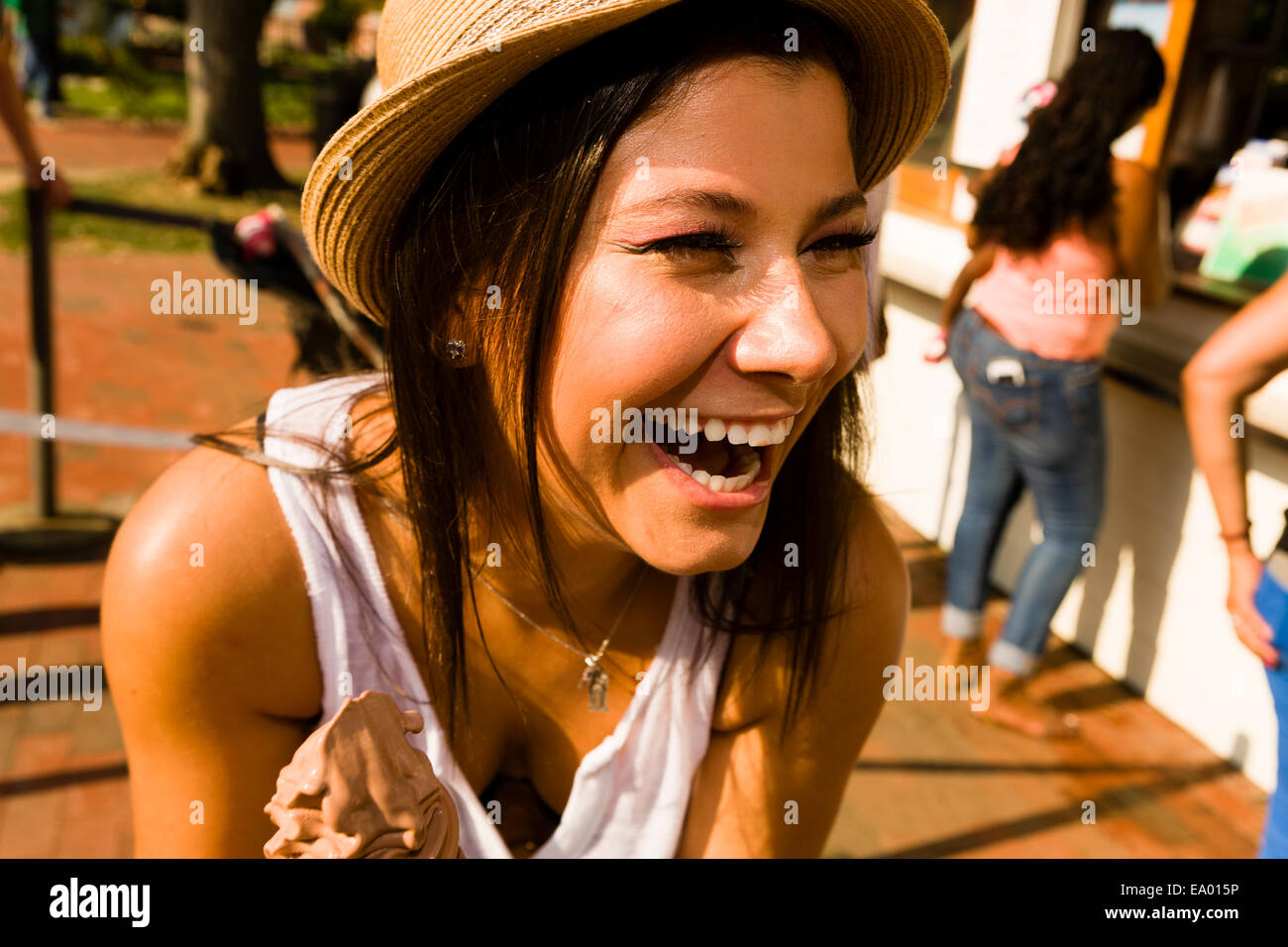 Young woman laughing in park Stock Photo
