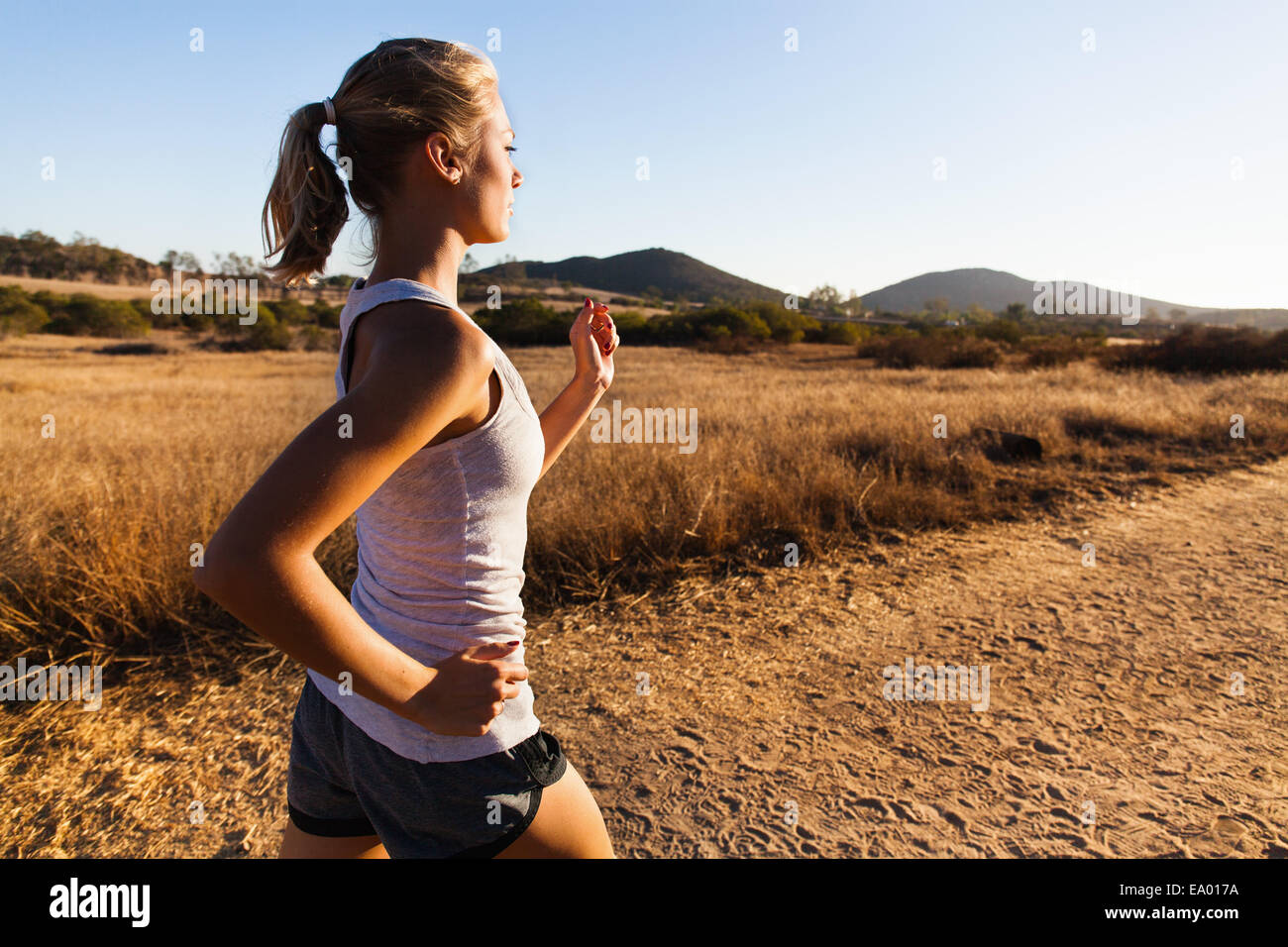 Young woman jogging, Poway, CA, USA - Stock Image