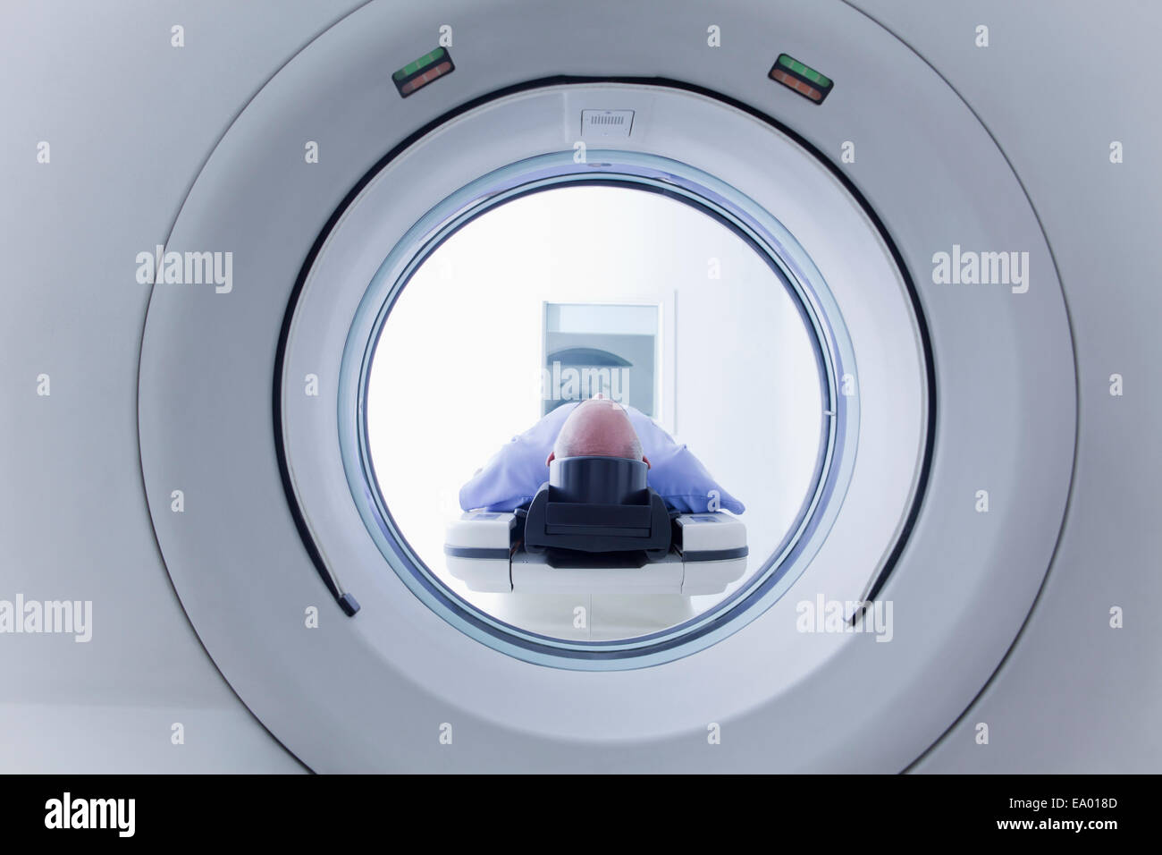 Patient lying down on CT scanner - Stock Image
