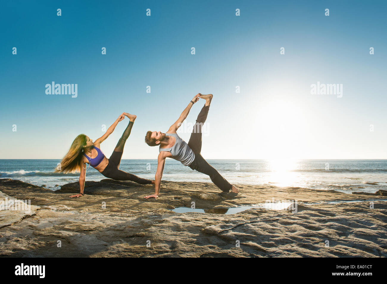 Side Plank Pose - Vasisthasana, Windansea beach, La Jolla, California - Stock Image