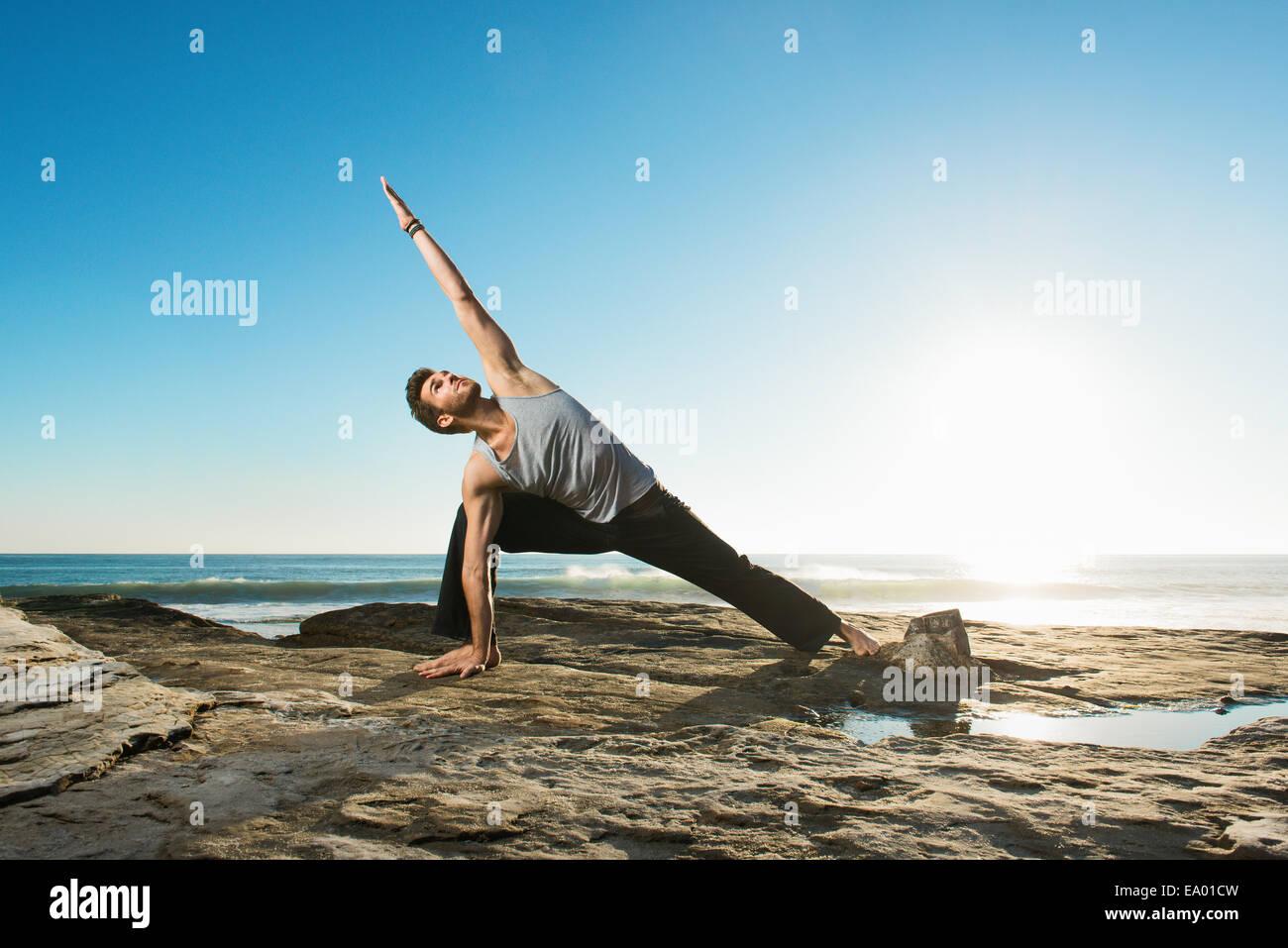 Extended Side Angle Pose - Utthita Parsvakonasana, Windansea beach, La Jolla, California - Stock Image
