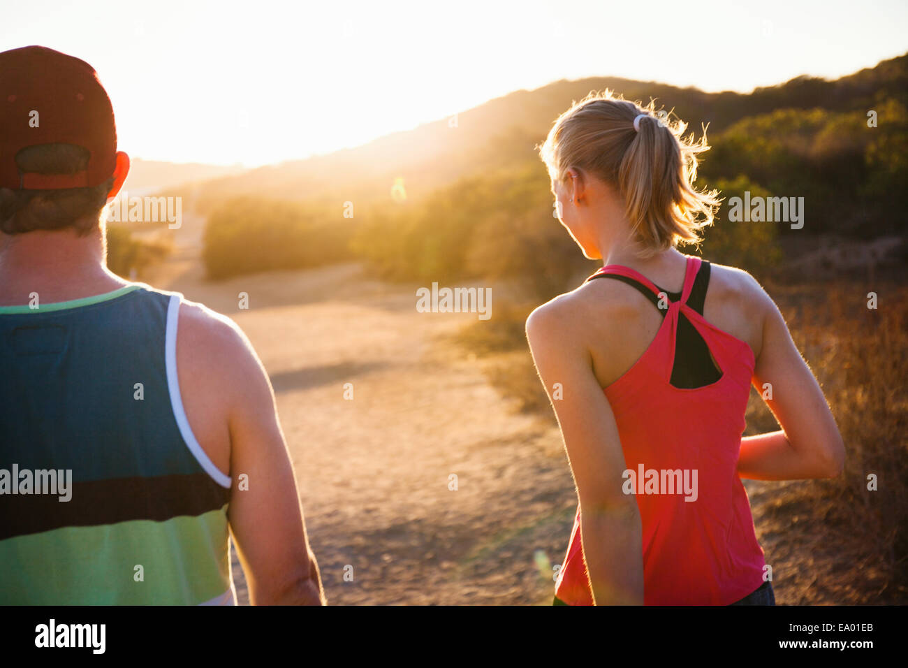 Joggers walking on sunlit path, Poway, CA, USA - Stock Image