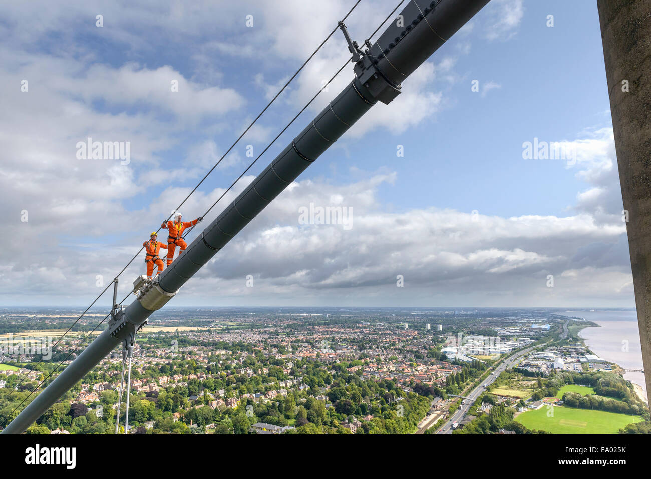 Bridge workers walking on cable of suspension bridge Humber Bridge UK was built in 1981 - Stock Image