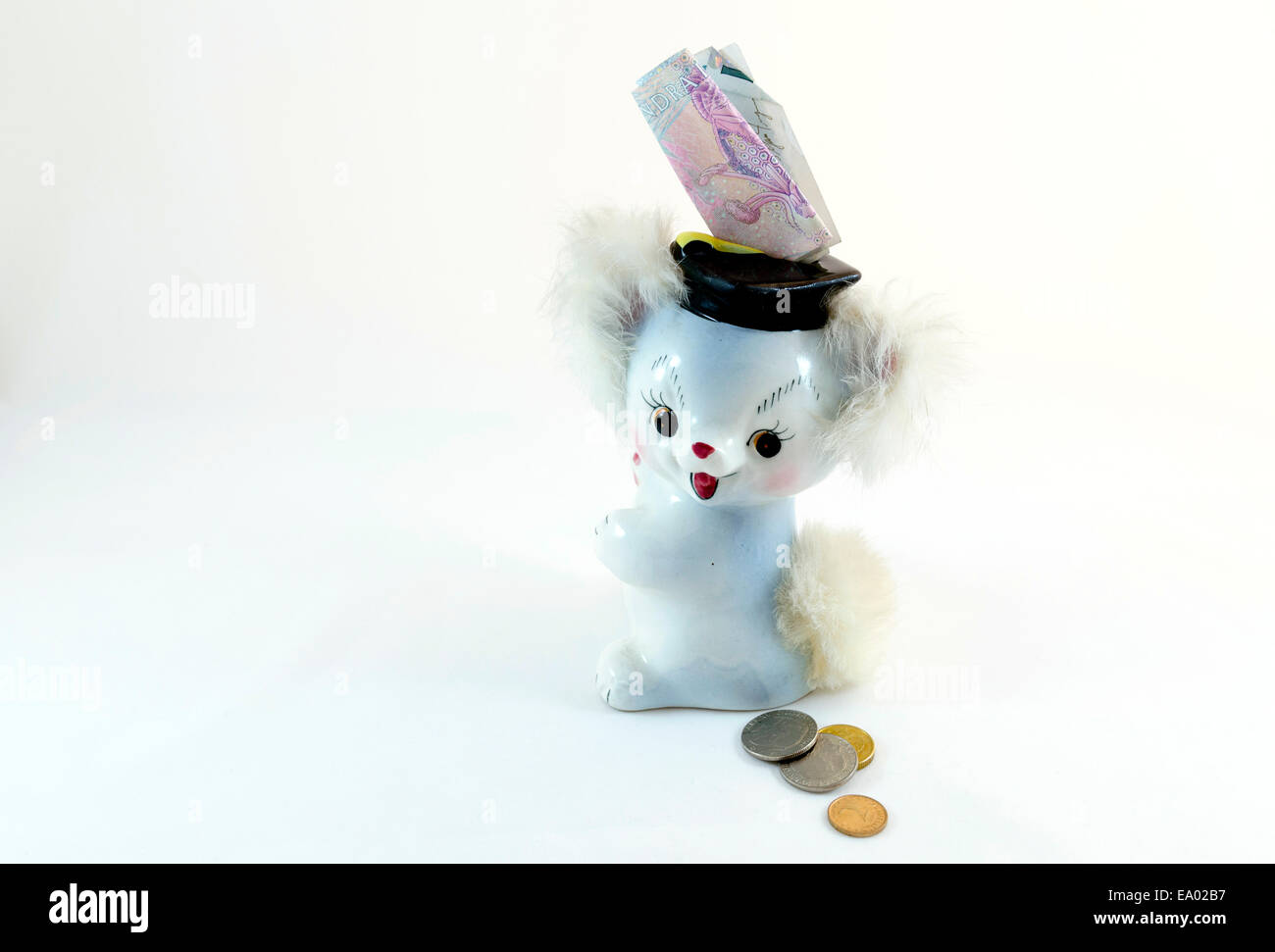 A little happy money box with some money coming in - Stock Image