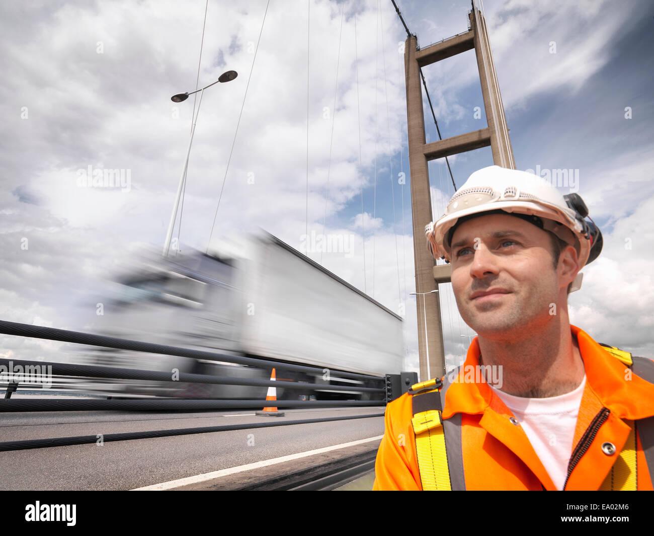 Bridge worker close to traffic on suspension bridge Humber Bridge UK was built in 1981 Stock Photo