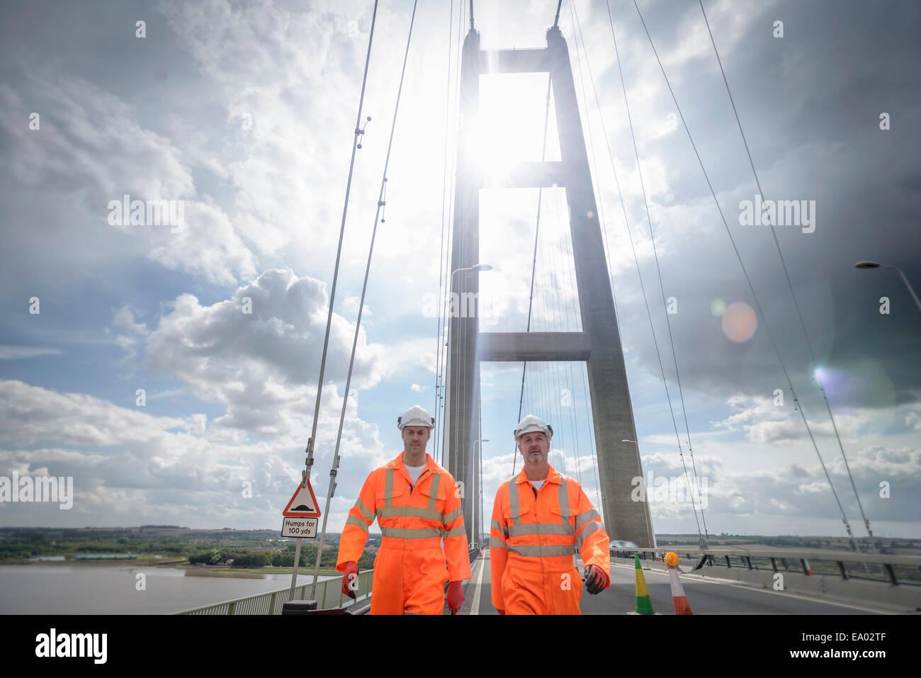 Workers walking along roadway of suspension bridge Humber Bridge UK was built in 1981 - Stock Image