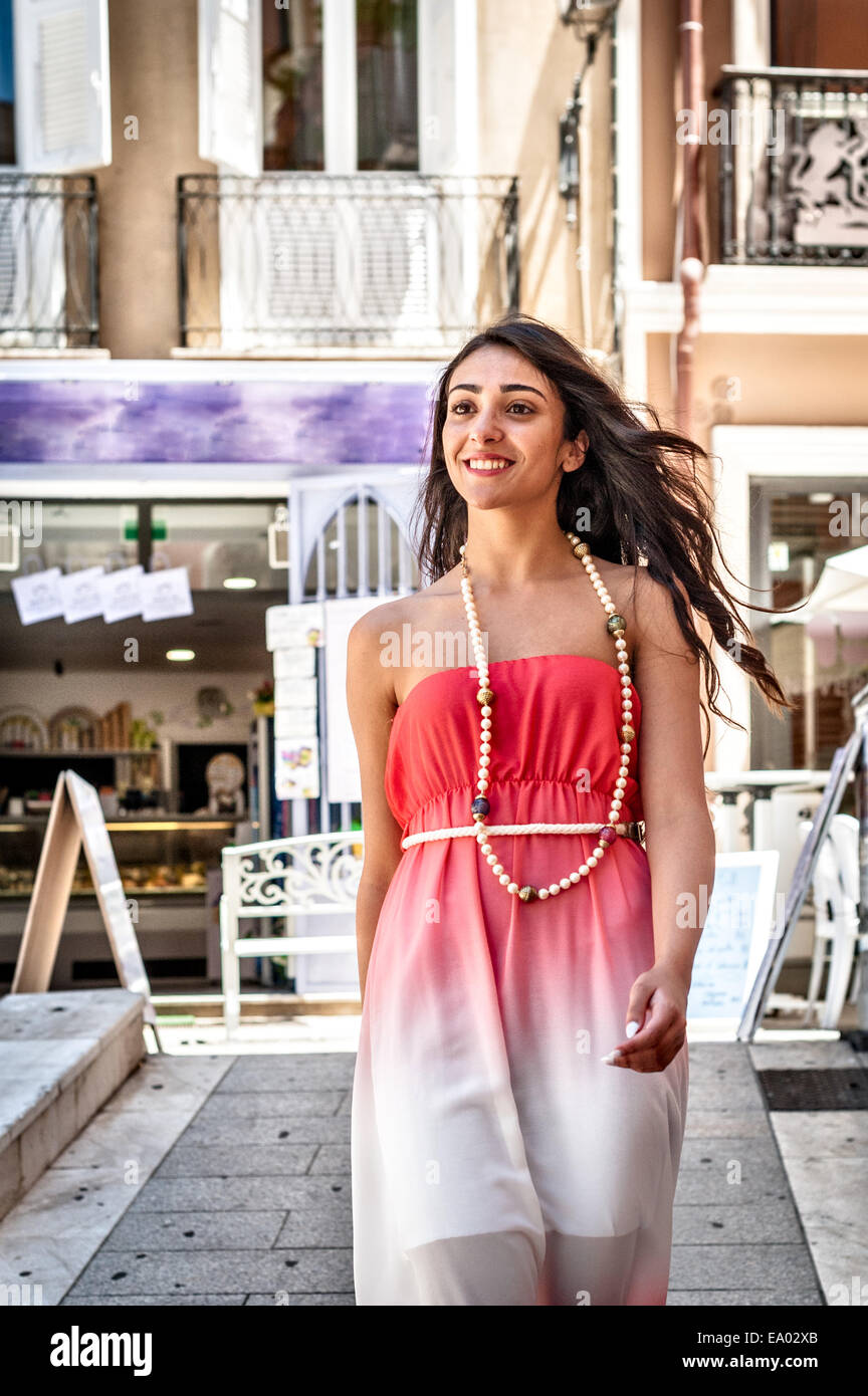 Fashionable young woman strolling down street, Cagliari, Sardinia, Italy - Stock Image