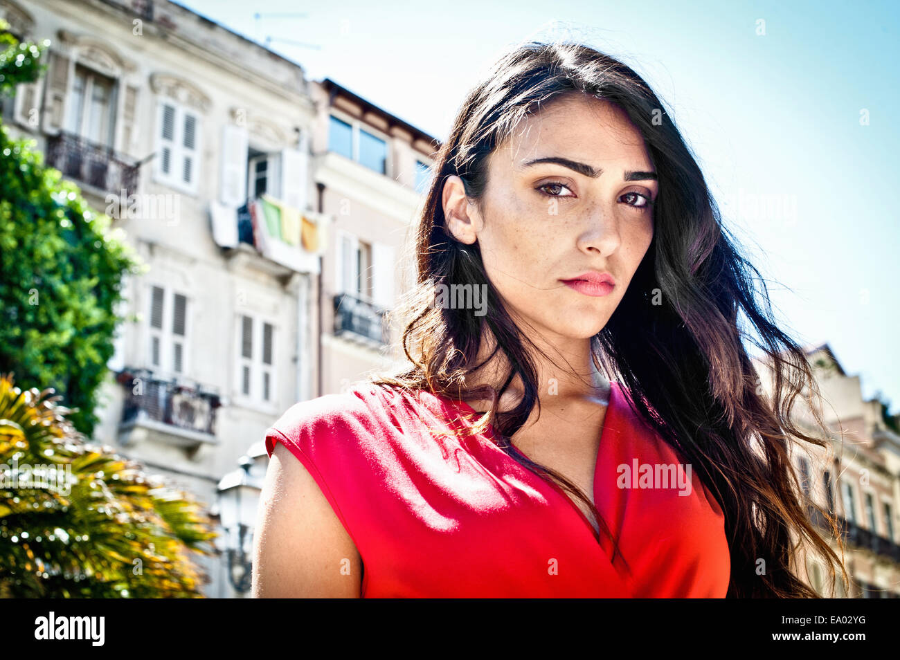 Portrait of sultry young woman on street, Cagliari, Sardinia, Italy - Stock Image