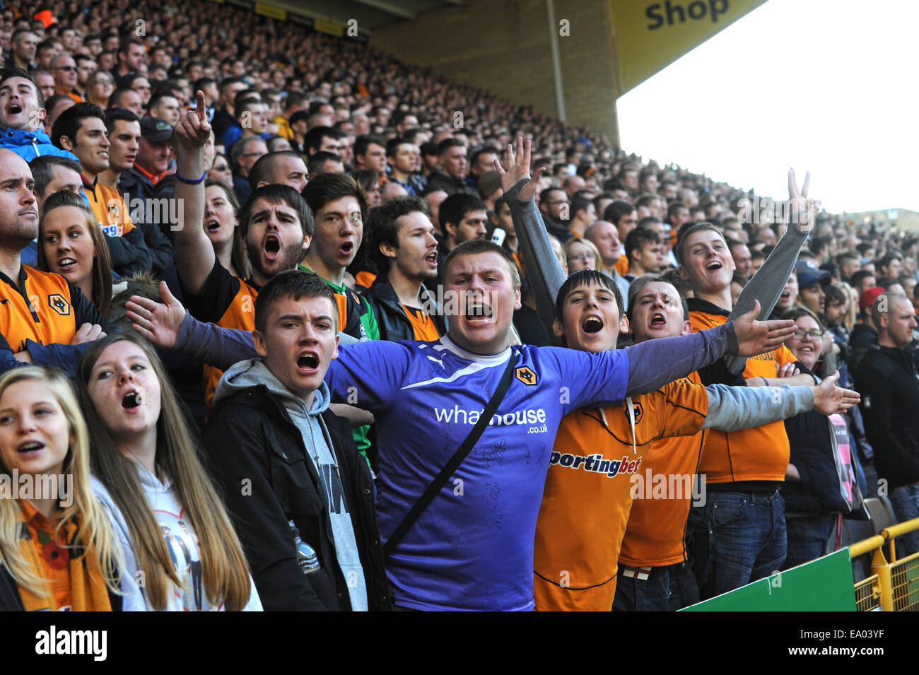 Football supporters fans crowd chanting watching match Wolverhampton Wanderers fans Uk - Stock Image