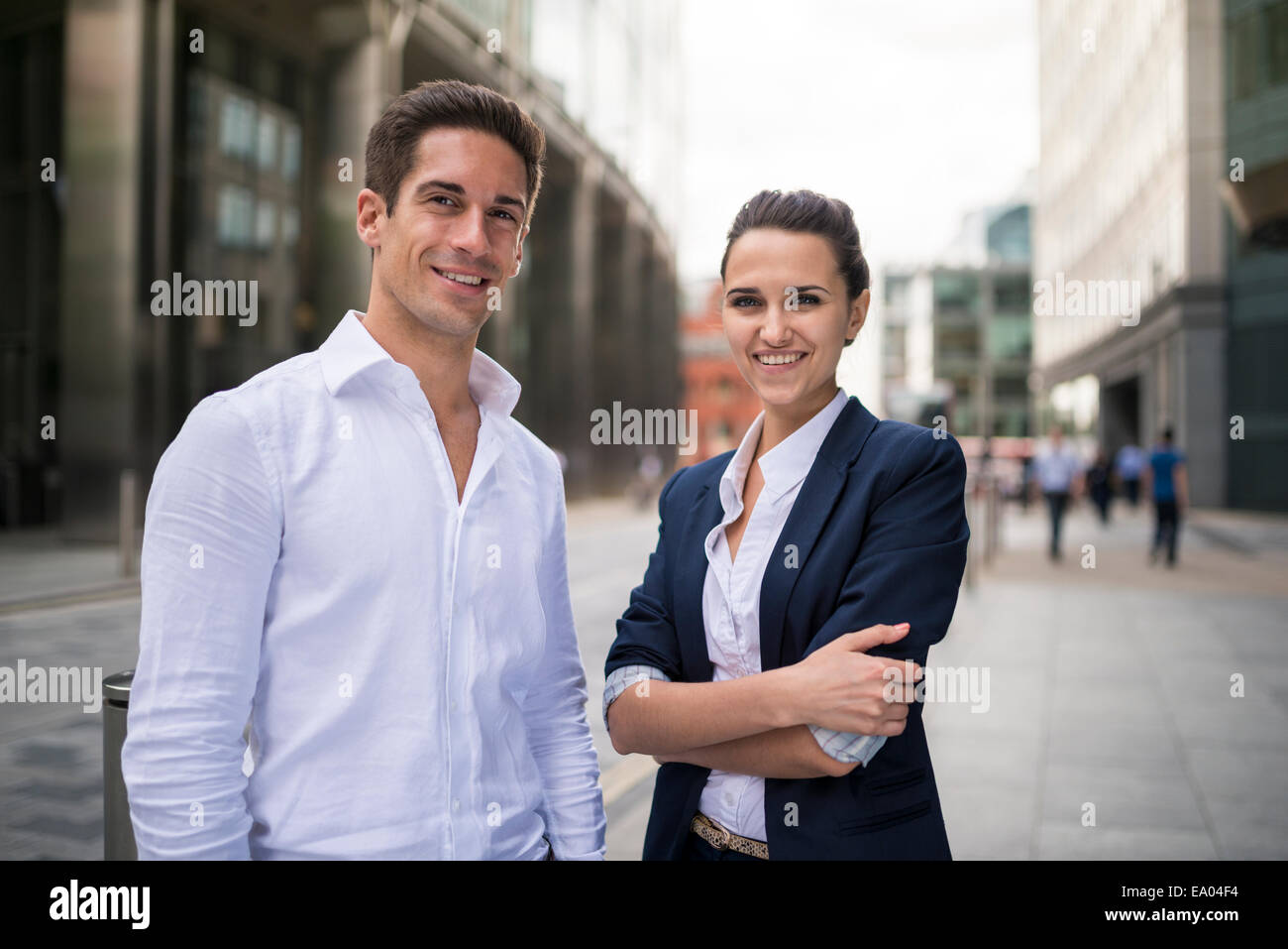 Portrait of young business partners on street, London, UK - Stock Image