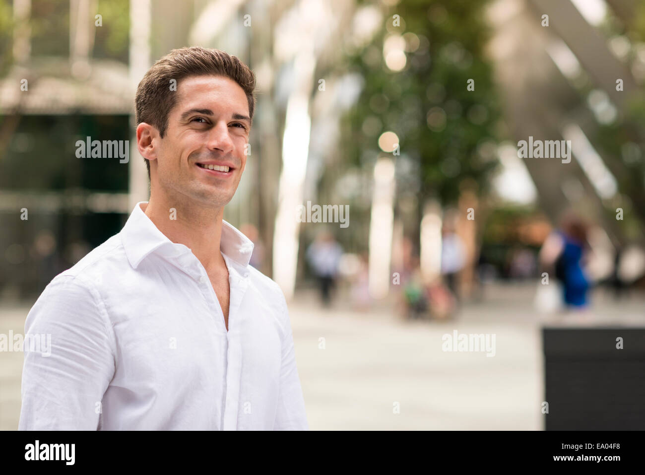 Confident young businessman at Broadgate Tower, London, UK - Stock Image