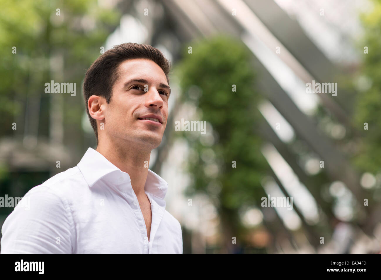Young confident businessman at Broadgate Tower, London, UK - Stock Image