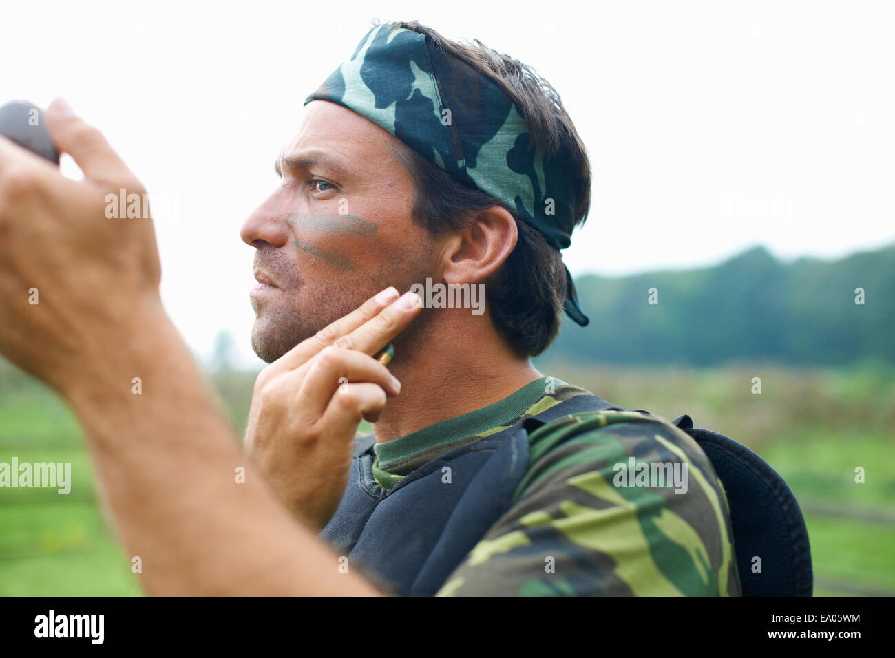 Paintball player in combat gear - Stock Image