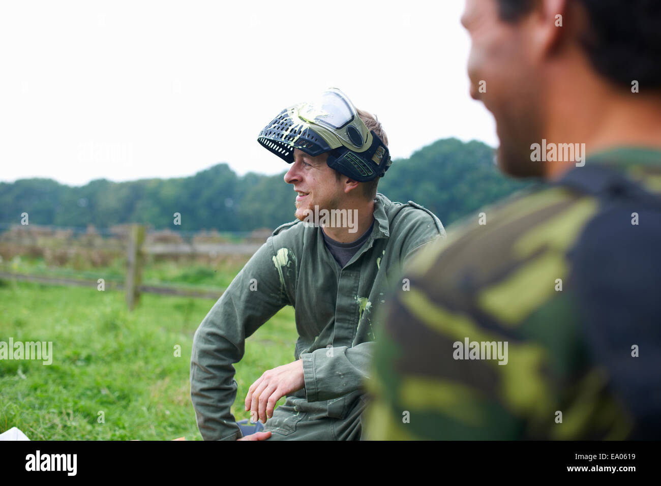 Paintball players preparing and planning game - Stock Image