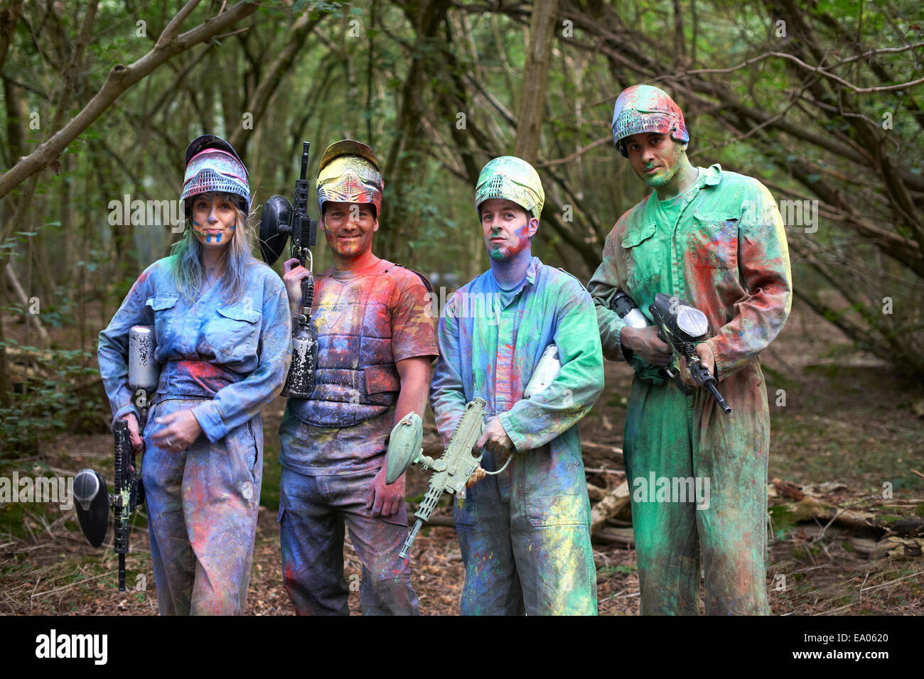 Paintball players in paintball wear marked with paint Stock Photo