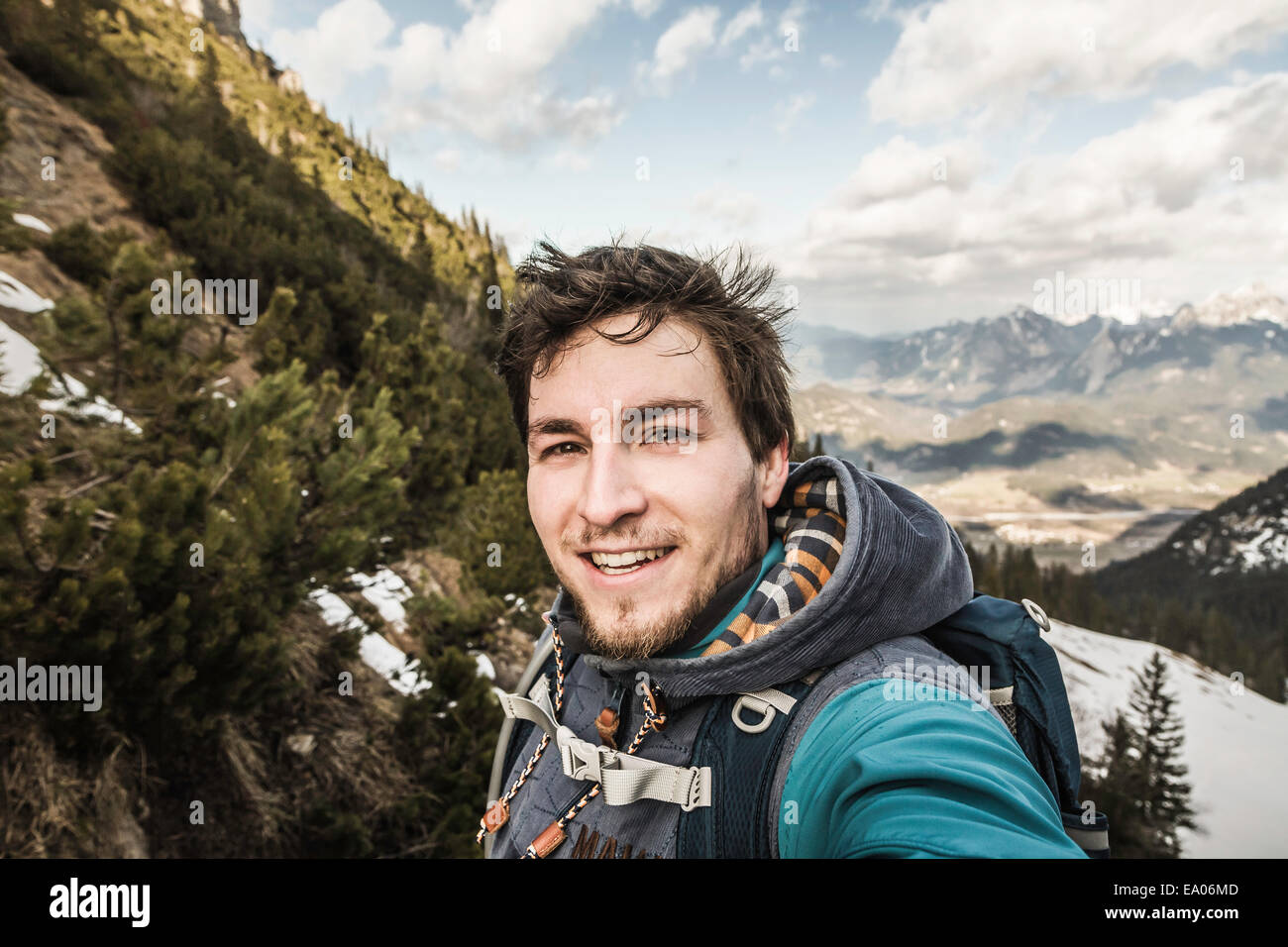 Self portrait of young man in mountains, Hundsarschjoch, Vils, Bavaria, Germany Stock Photo