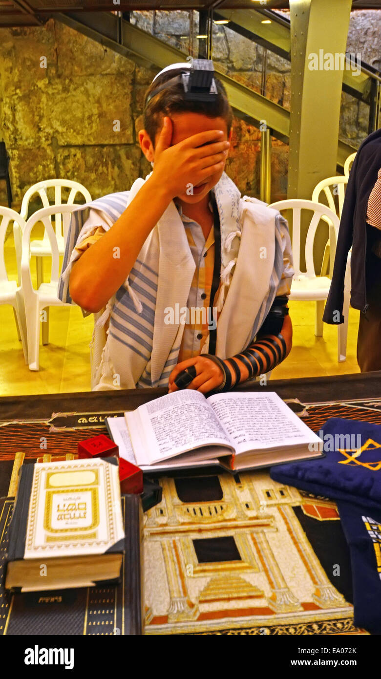 Jewish Bar Mitzva boy with Tfilin near the Western wall In Jerusalem, Israel - Stock Image