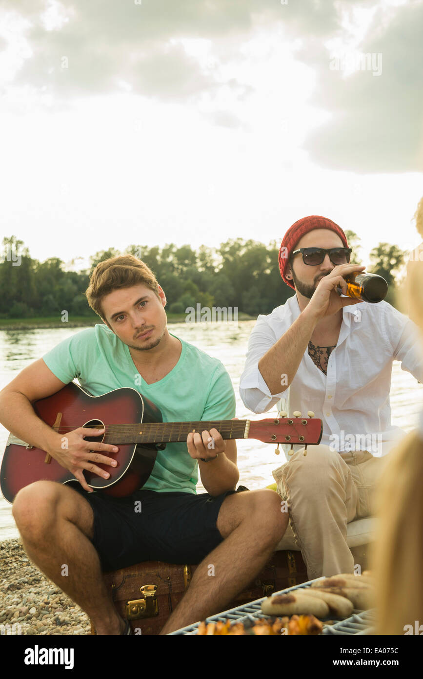 Young man playing guitar - Stock Image