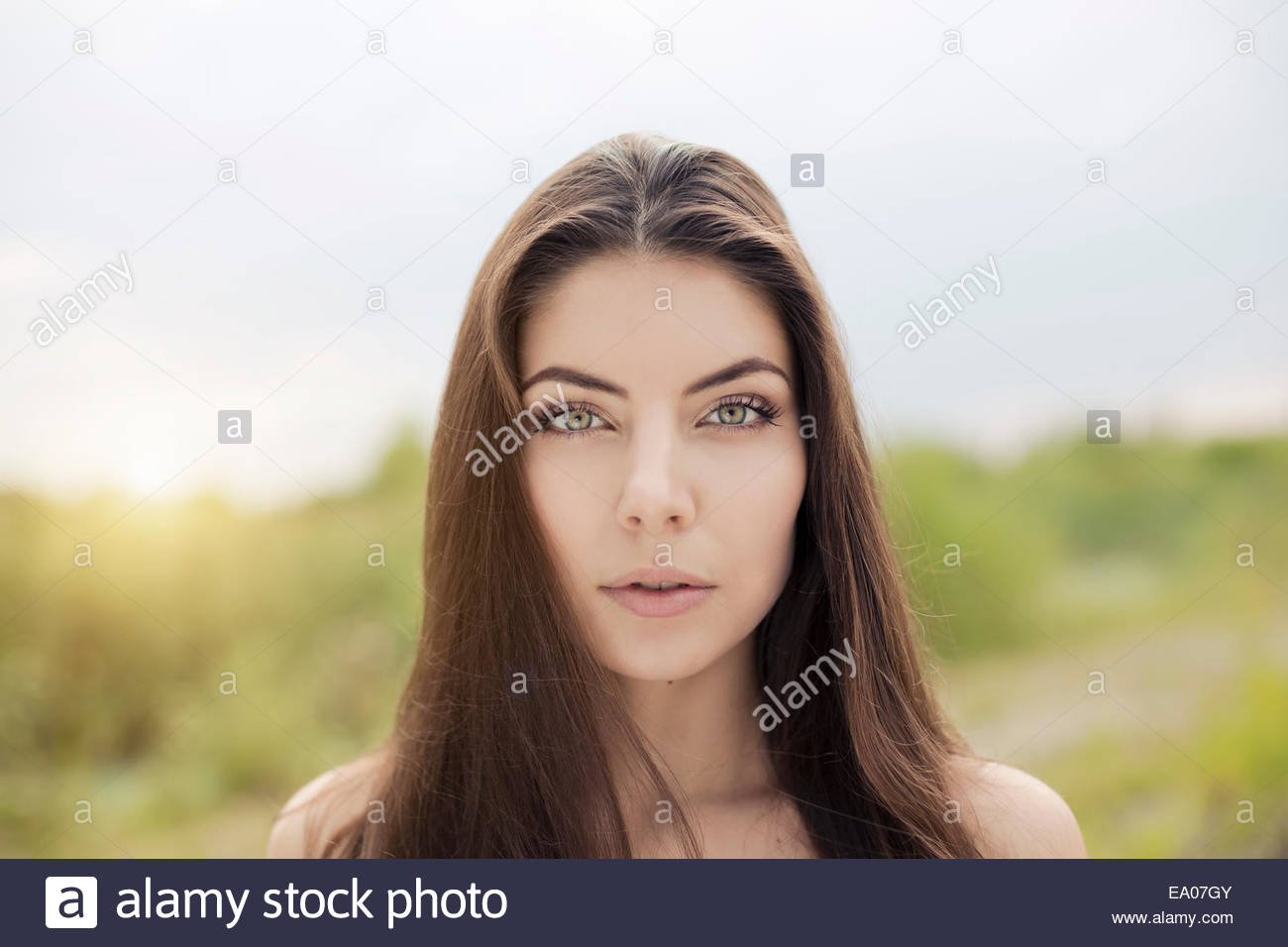 Bare shoulder portrait of beautiful young woman - Stock Image