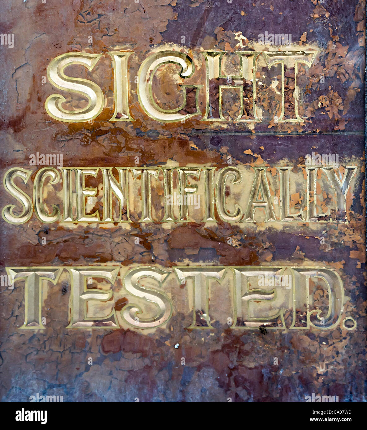 Faded sign on optician's shop Sight scientifically tested, Clonmel, Ireland - Stock Image