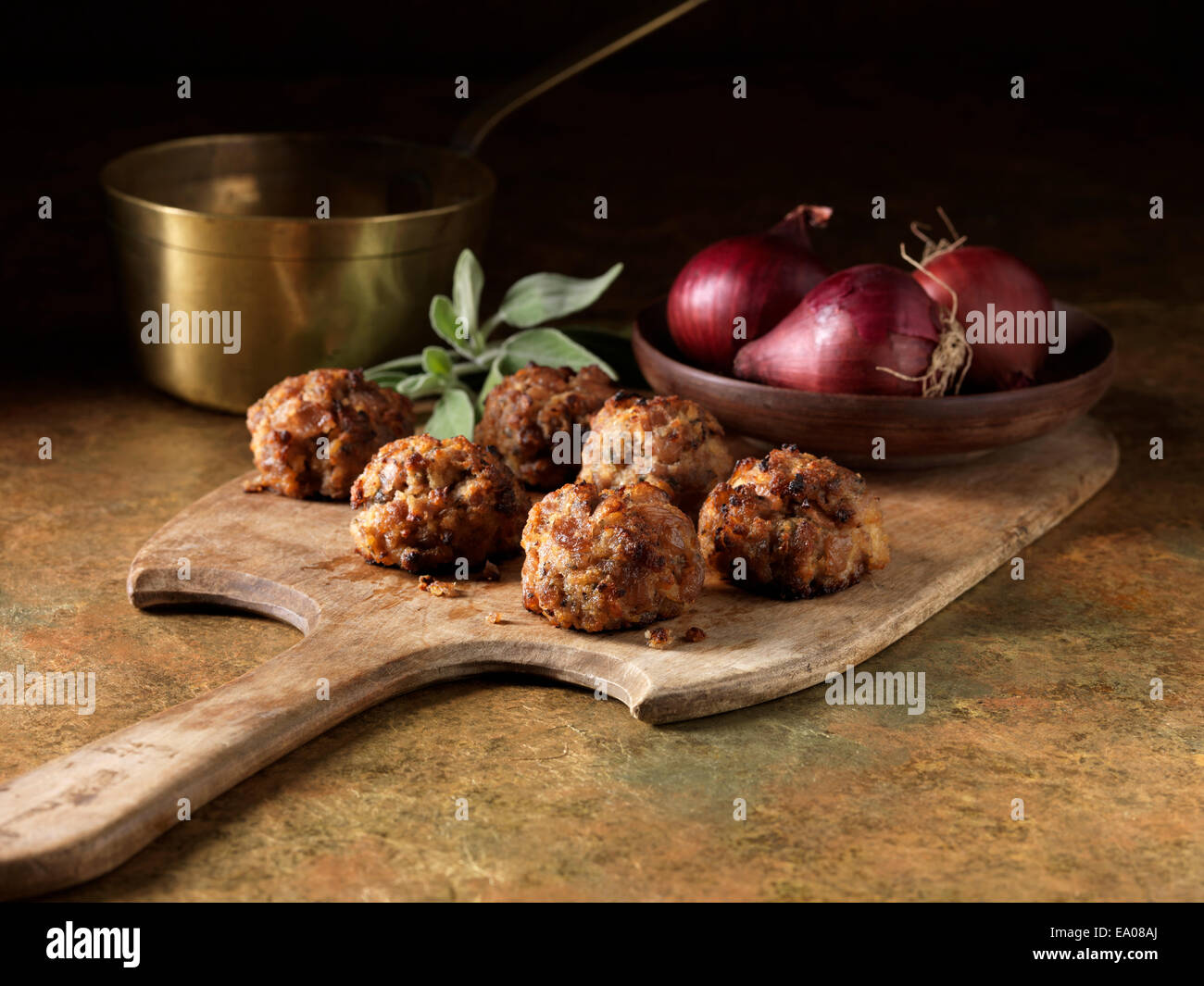 Festive Christmas ingredients of pork, caramelized red onion with sage and red onion - Stock Image