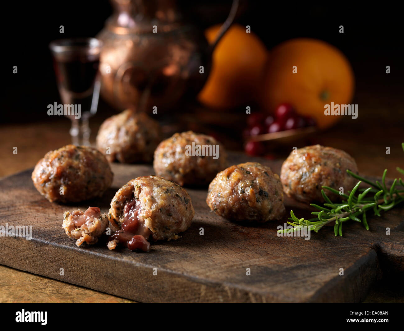 Christmas ingredients of pork orange rosemary stuffing balls with port cranberry sauce centres Oranges a glass of - Stock Image