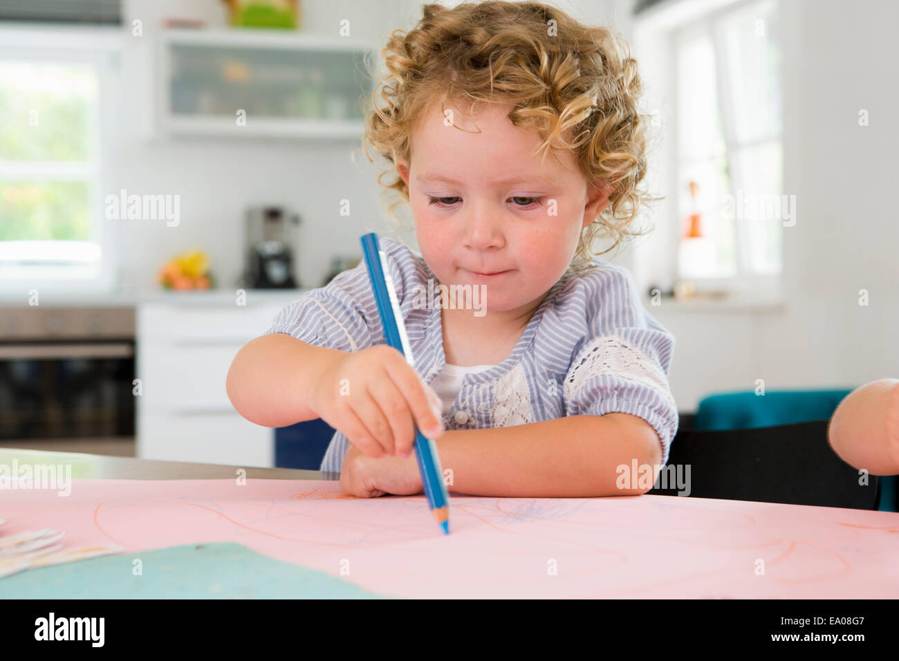 Girl drawing with pencil - Stock Image